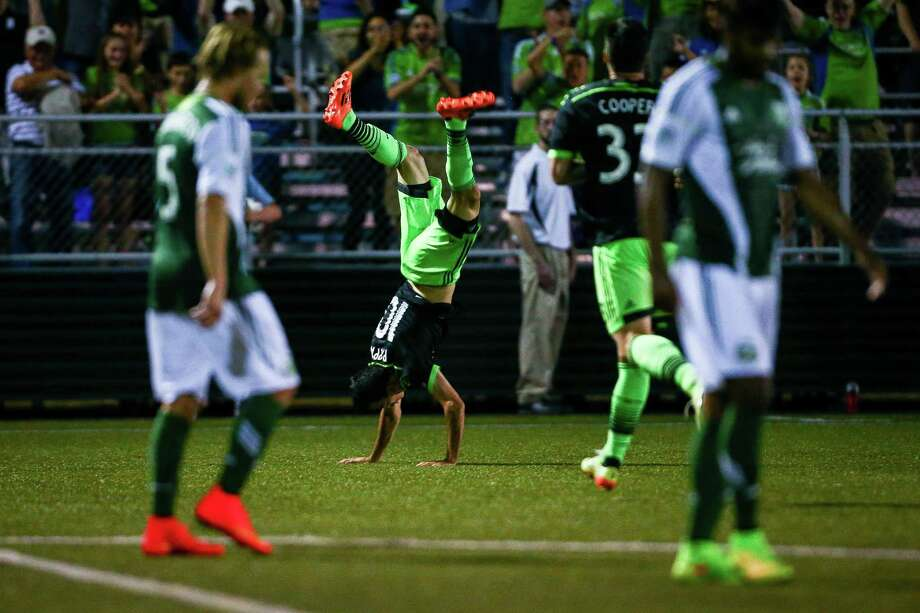 Marco Pappa (10) flips after scoring a goal in extra time during the Lamar Hunt U.S. Open Cup Quarterfinals match between Seattle Sounders FC and the Portland Timbers  on Wednesday, July 9, 2014. The Sounders won the match 3-1. Photo: JOSHUA BESSEX, SEATTLEPI.COM / SEATTLEPI.COM