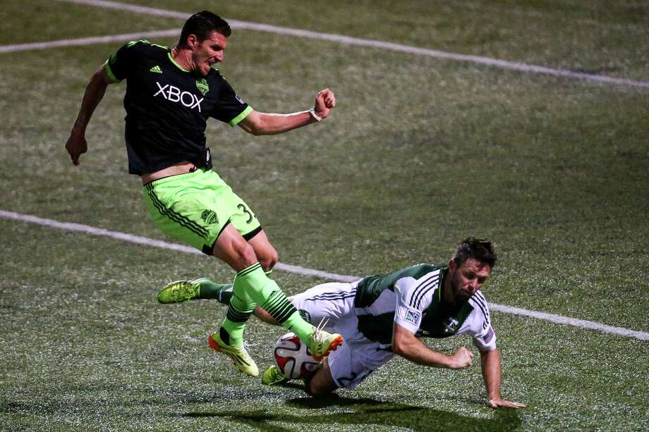 Kenny Cooper's shot is blocked during extra time in the Lamar Hunt U.S. Open Cup Quarterfinals match between Seattle Sounders FC and the Portland Timbers on Wednesday, July 9, 2014. The Sounders won the match 3-1. Photo: JOSHUA BESSEX, SEATTLEPI.COM / SEATTLEPI.COM