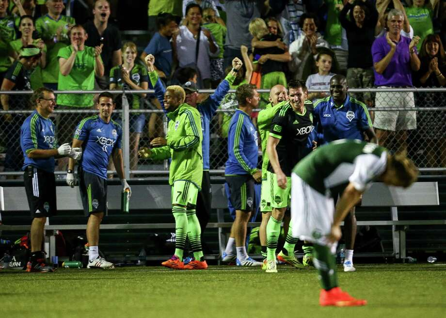Seattle celebrates after a goal during the Lamar Hunt U.S. Open Cup Quarterfinals match between Seattle Sounders FC and the Portland Timbers on Wednesday, July 9, 2014. The Sounders won the match 3-1. Photo: JOSHUA BESSEX, SEATTLEPI.COM / SEATTLEPI.COM
