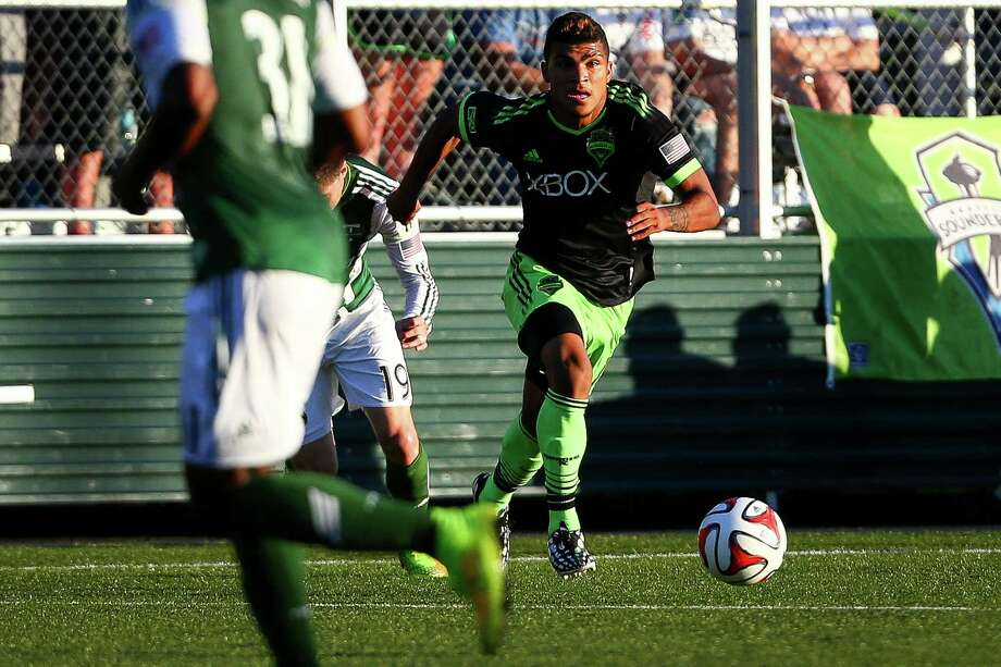 DeAndre Yedlin (17) dribbles the ball during the Lamar Hunt U.S. Open Cup Quarterfinals match between Seattle Sounders FC and the Portland Timbers on Wednesday, July 9, 2014. The Sounders won the match 3-1. Photo: JOSHUA BESSEX, SEATTLEPI.COM / SEATTLEPI.COM
