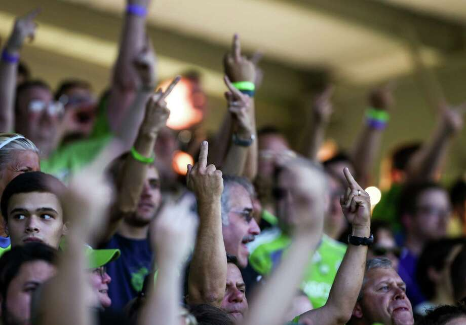 Seattle Sounders FC fans give the finger to Portland Timbers fans during the Lamar Hunt U.S. Open Cup Quarterfinals match between Seattle Sounders FC and the Portland Timbers on Wednesday, July 9, 2014. The Sounders won the match 3-1. Photo: JOSHUA BESSEX, SEATTLEPI.COM / SEATTLEPI.COM