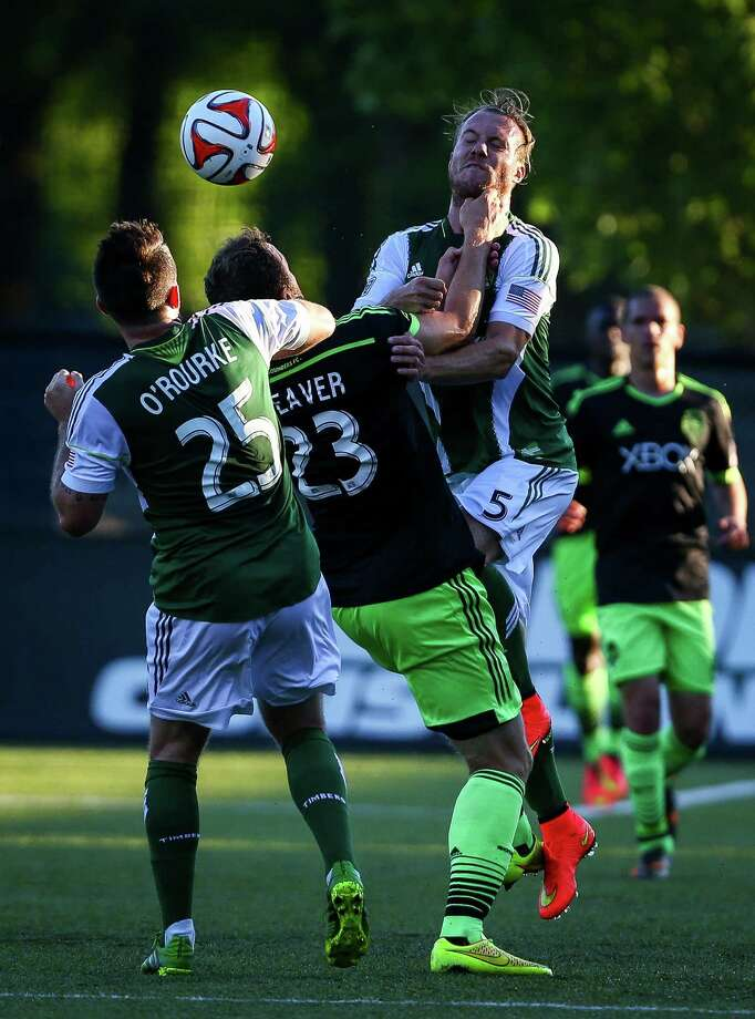 Cam Weaver (23) collides with Portland's Michael Harrington (5) during the Lamar Hunt U.S. Open Cup Quarterfinals match between Seattle Sounders FC and the Portland Timbers on Wednesday, July 9, 2014. The Sounders won the match 3-1. Photo: JOSHUA BESSEX, SEATTLEPI.COM / SEATTLEPI.COM