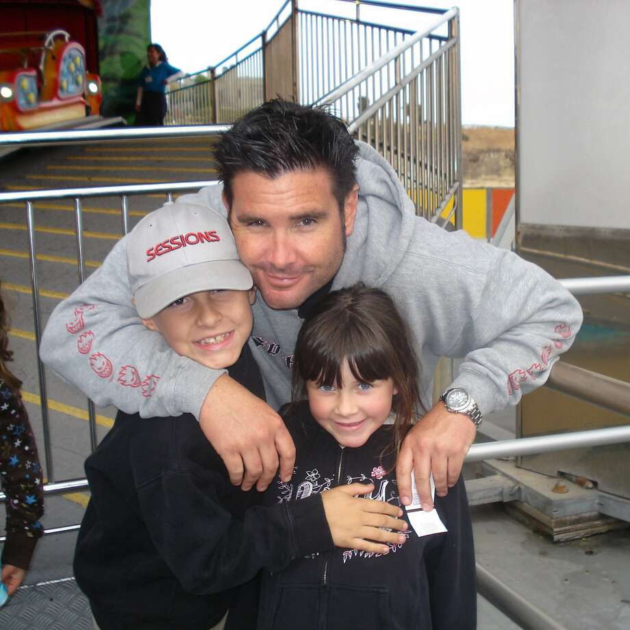 Bryan Stow and children in photo before the attack. Photo: John STow, Associated Press