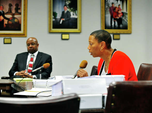 Beaumont ISD board president Gwen Ambres responds to a question from attorney Chris Tritico during Friday's hearing at the Texas Education Agency.