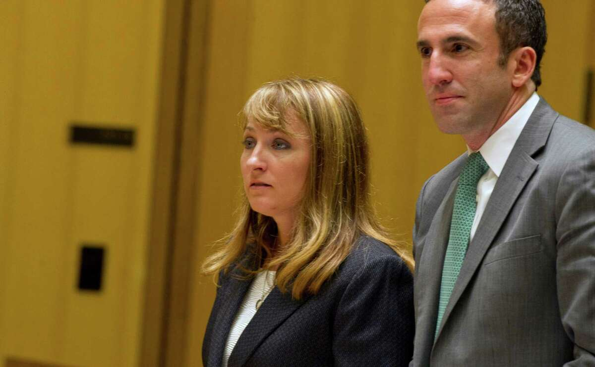 Former animal shelter Director Laurie Hollywood appears in State Superior Court in Stamford, Conn., on three counts of reckless endangerment on Thursday, July 10, 2014.