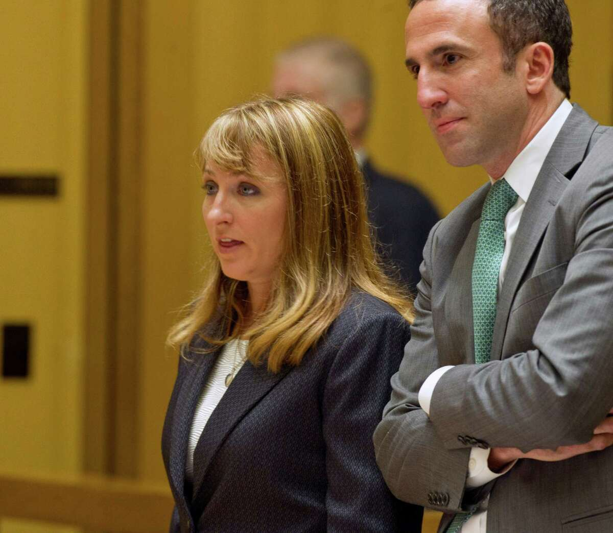 Former animal shelter Director Laurie Hollywood appears in State Superior Court with her lawyer, Mark Sherman, in Stamford, Conn., on three counts of reckless endangerment on Thursday, July 10, 2014.