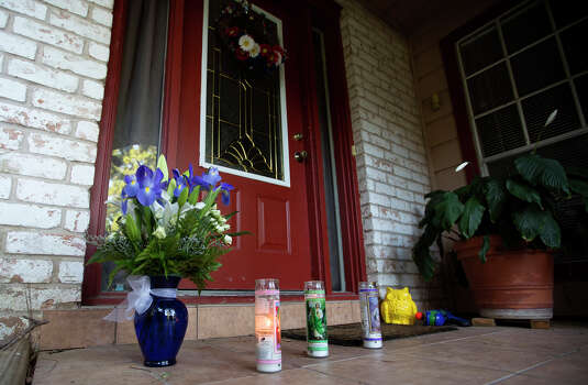 Flowers and candles are seen in front of the home where seven people were shot, Thursday, July 10, 2014, in Spring. The shooting took place Wednesday killing six people including four children and two adults, who were shot to death after an apparent domestic dispute. Photo: Cody Duty, Houston Chronicle / © 2014 Houston Chronicle