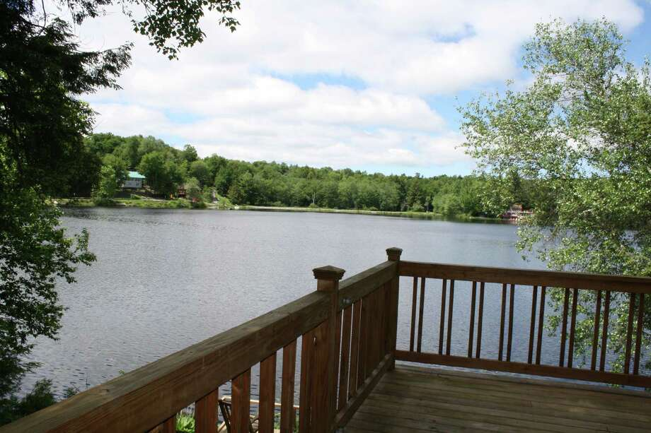 Please find attached some photos of a lake property listing - 32 Forest Rd at Lake Desolation in Middle Grove, NY.  This is a 2 bedroom, 1 bath camp with a great enclosed porch, deck and lovely waterfront.  Great for boating, fishing and relaxing.  has just been on the market for 3 weeks, listed by Carole Tarantino and Cynthia Manz of Roohan Realty.
