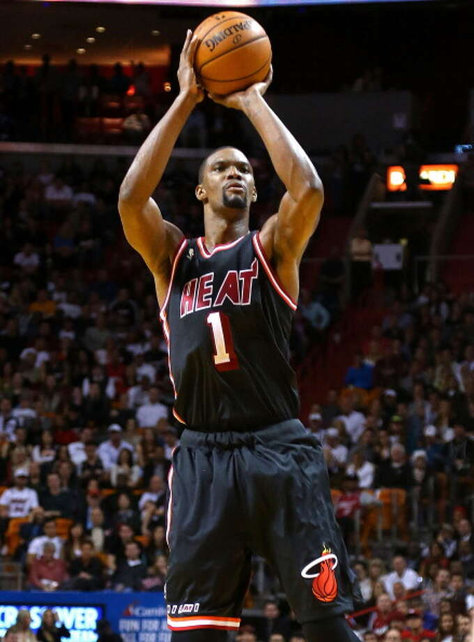 With his nice outside touch and solid defensive ability, Chris Bosh is one of the NBA's most unique big men. Here's a look at his hoops career. Photo: Mike Ehrmann, Getty Images / 2014 Getty Images