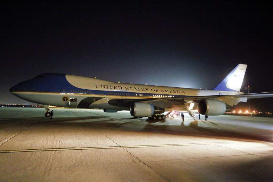 Air Force One sits on the tarmac of Austin-Bergstrom International Airport on Wednesday, July 9, 2014, in Austin, Texas. President Barack Obama is spending the night in the Texas capital and on Thursday he will make a speech on the economy. (AP Photo/Jack Plunkett) Photo: Jack Plunkett, Associated Press / FR59553 AP