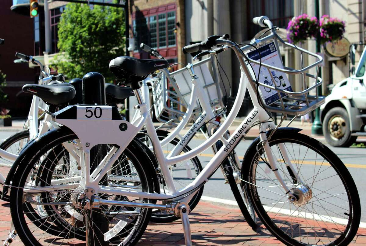 Free bikes for renting as part of the BikeShare program by the Capital District Transportation Committee are ready for use during a week-long test in July 2014 on State St. in Schenectady, N.Y. (Selby Smith/Special to the Times Union)