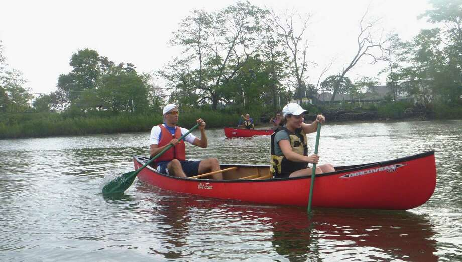 SoundWaters in Stamford, Conn., recently launched a guided canoe tour for Saturdays on Holly Pond in Cove Island Park. Trips are at 10 a.m. and 12 p.m. To learn more, visit www.soundwaters.org/canoes/. Photo: Contributed Photo / Connecticut Post Contributed