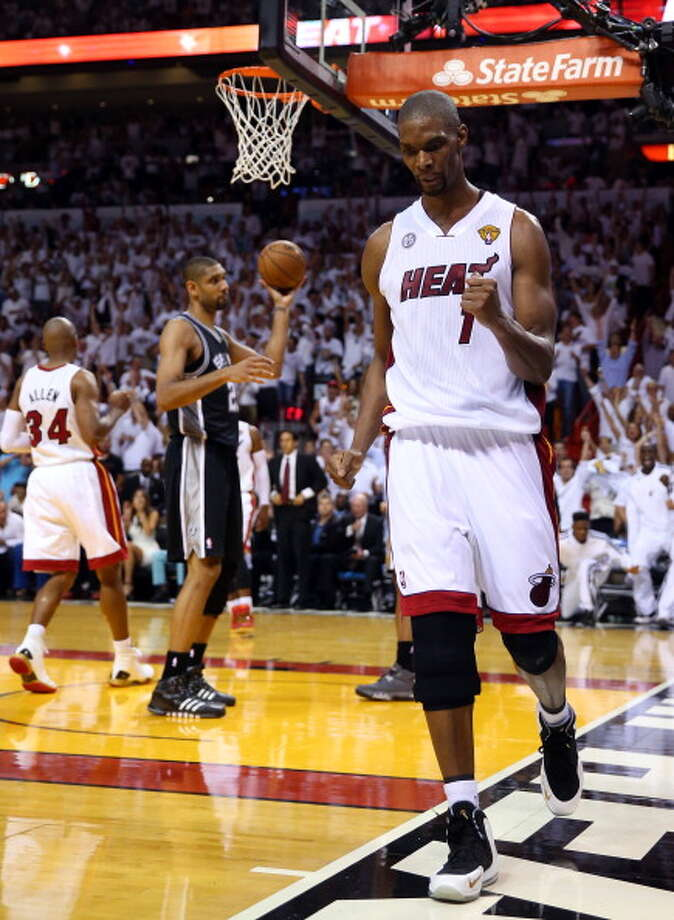 2012-13 season  Bosh and the Heat survived a seven-game battle with the Spurs in the 2013 NBA Finals to capture their second straight title. Photo: Mike Ehrmann, Getty Images / 2013 Getty Images