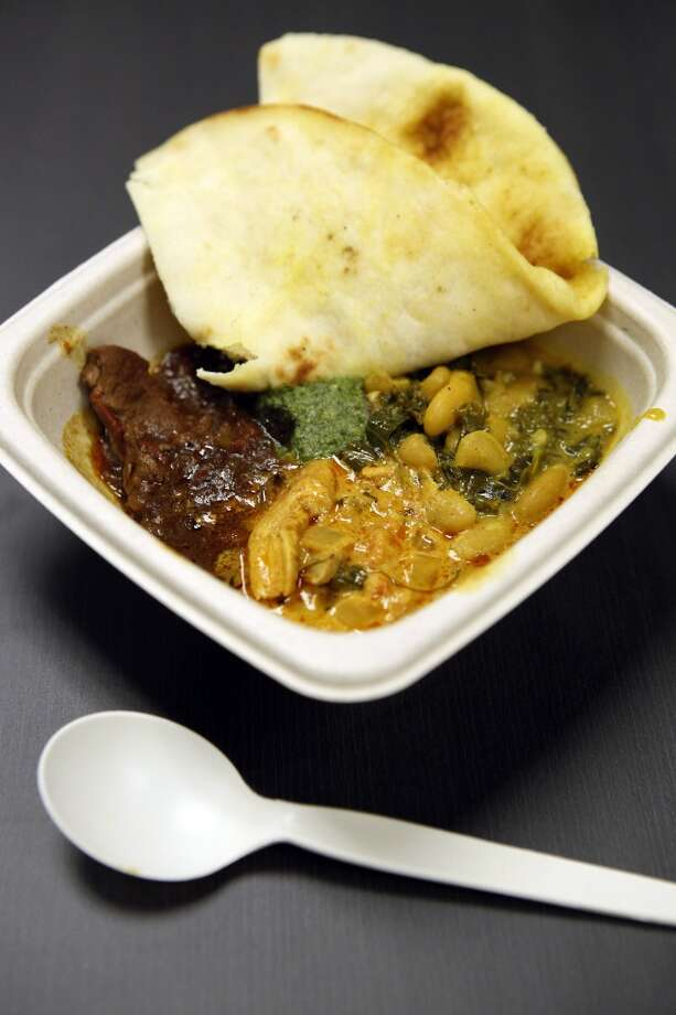 A bowl containing Rajisthani Lamb Curry, Tikki Masala and Navy Bean & Kale Curry with rice and naan bread. Photo: Michael Short, The Chronicle
