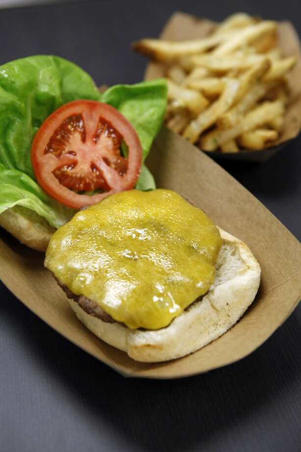 The grass-fed Burger with Tillamook Cheddar and garlic-Parmesan mayo. Photo: Michael Short, The Chronicle