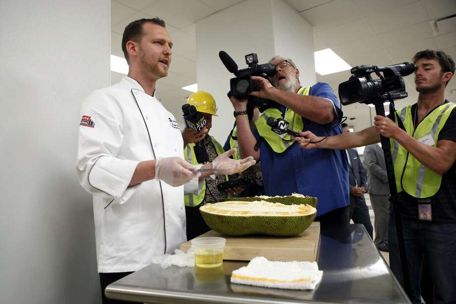 Executive chef Ryan Stone cuts through a jackfruit as he shows off food that will be available to fans visiting the 49ers' new Levi's Stadium in Santa Clara, CA, Wednesday, July 9, 2014. Photo: Michael Short, The Chronicle