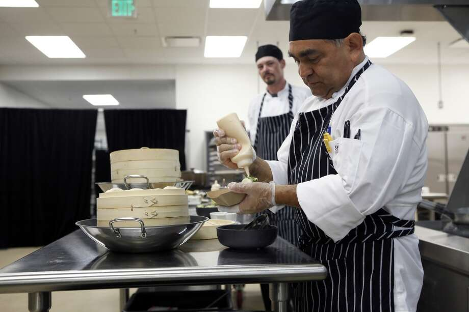Sous chef Bill Nevarez puts together steamed buns in the kitchen area at the 49ers' new Levi's Stadium in Santa Clara, CA, Wednesday, July 9, 2014. Photo: Michael Short, The Chronicle
