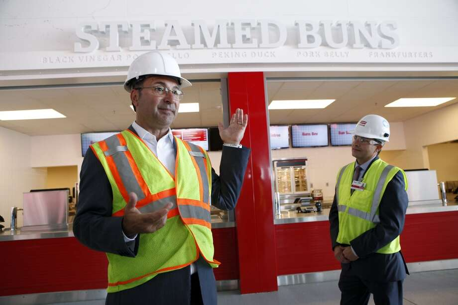 Centerplate's chief design officer John Sergi, left, and general manager Zach Hensley show of features of the concession stands on the main concourse level at the 49ers' new Levi's Stadium in Santa Clara, CA, Wednesday, July 9, 2014. Photo: Michael Short, The Chronicle