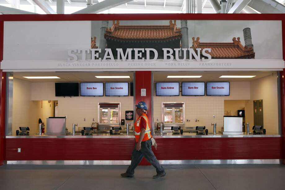 A construction worker walks past a concession stand that will sell steamed buns at the 49ers' new Levi's Stadium in Santa Clara, CA, Wednesday, July 9, 2014. Photo: Michael Short, The Chronicle