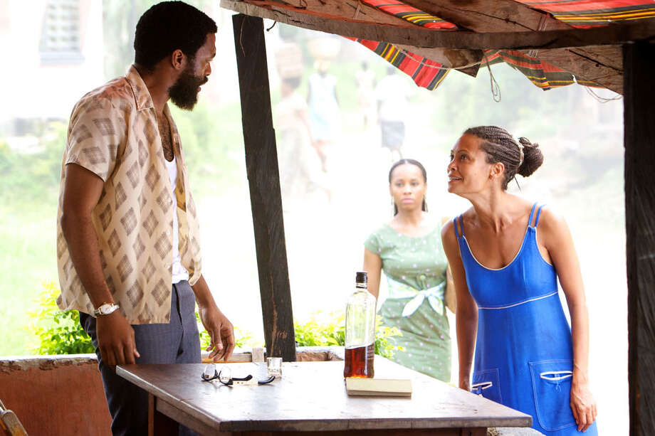 "The troubled relationship between Odenigbo (Chiwetel Ejiofor) and Olanna (Thandie Newton, far right) is at the heart of ""Half of a Yellow Sun."" / ©2012 Shareman Media Limited / The British Film Limited/Yellow Sun Limited"