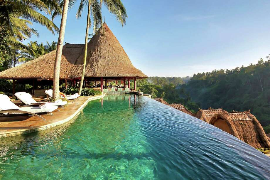 The main pool and restaurant at the Viceroy Bali overlooks the verdant Valley of the Kings. / Viceroy Bali