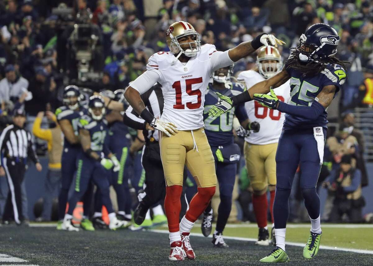 Seattle Seahawks' Richard Sherman reaches out to shake hands with then-49ers' Michael Crabtree after Sherman tipped a pass in the end zone intended for Crabtree.