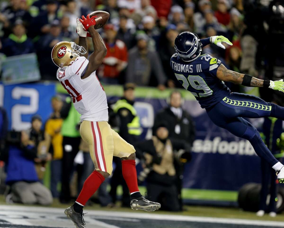 Anquan Boldin (81) caught a touchdown pass past defender Earl Thomas in the second half Sunday January 19, 2014. The Seattle Seahawks defeated the San Francisco 49ers 23-17 to win the NFC championship and a trip to the Super Bowl at CenturyLink Field in Seattle, Washington.