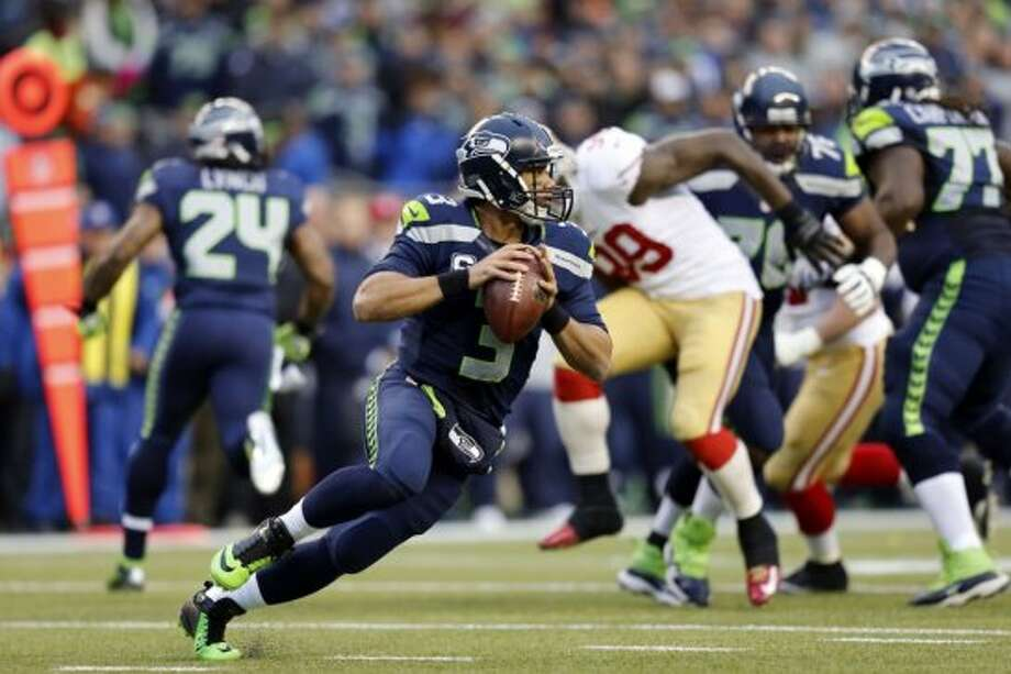 Seattle quarterback Russell Wilson, (3) scrambles out of the pocket in the first half, as the San Francisco 49ers take on the Seattle Seahawks in the NFC Championship game at CenturyLink Field in Seattle, Washington on Sunday Jan. 19,  2014. Photo: Michael Macor, The Chronicle