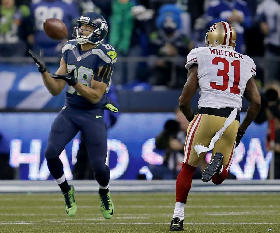 Doug Baldwin (89) of the Seahawks made a long catch in the first half as Donte Whitner (31) defended Sunday January 19, 2014. The Seattle Seahawks defeated the San Francisco 49ers 23-17 to win the NFC championship and a trip to the Super Bowl at CenturyLink Field in Seattle, Washington. Photo: Brant Ward, The Chronicle
