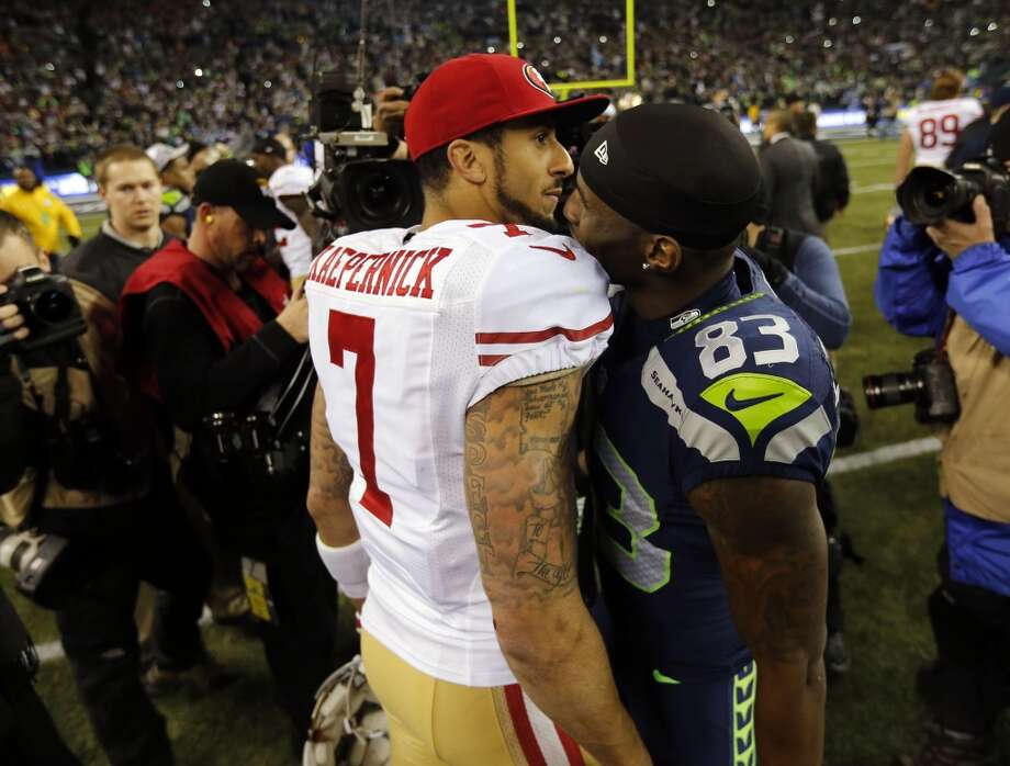 49er quarterback  quarterback Colin Kaepernick, (7) and Seattle's Ricardo Lockette, (83) greet each other after the 49ers lost to the Seattle Seahawks 23-17 in the NFC Championship game at CenturyLink Field in Seattle, Washington on Sunday Jan. 19,  2014. Photo: Michael Macor, The Chronicle