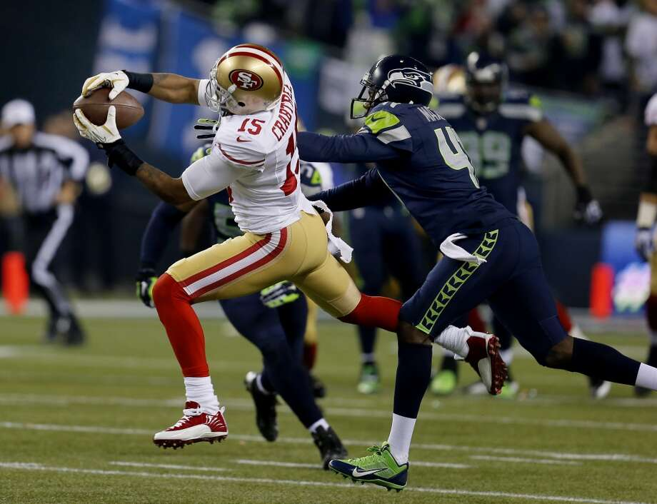 Michael Crabtree (15) made a reception in the second half Sunday January 19, 2014. The Seattle Seahawks defeated the San Francisco 49ers 23-17 to win the NFC championship and a trip to the Super Bowl at CenturyLink Field in Seattle, Washington. Photo: Brant Ward, The Chronicle