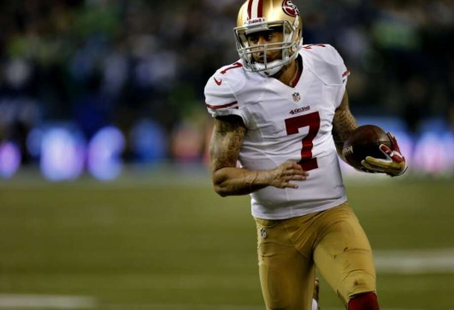 Colin Kaepernick (7) took off for a first down run in the second half Sunday January 19, 2014. The Seattle Seahawks defeated the San Francisco 49ers 23-17 to win the NFC championship and a trip to the Super Bowl at CenturyLink Field in Seattle, Washington. Photo: Brant Ward, The Chronicle