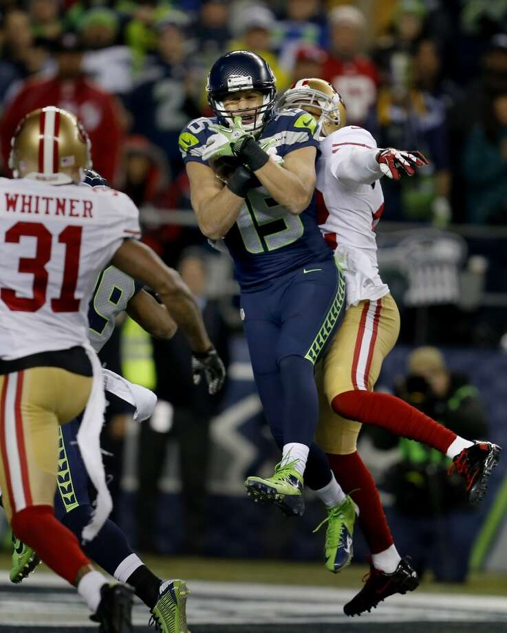 Seattle's Jermaine Kearse (15) caught a touchdown pass on a fourth down play in the second half Sunday January 19, 2014.  The Seattle Seahawks defeated the San Francisco 49ers 23-17 to win the NFC championship and a trip to the Super Bowl at CenturyLink Field in Seattle, Washington. Photo: Brant Ward, The Chronicle