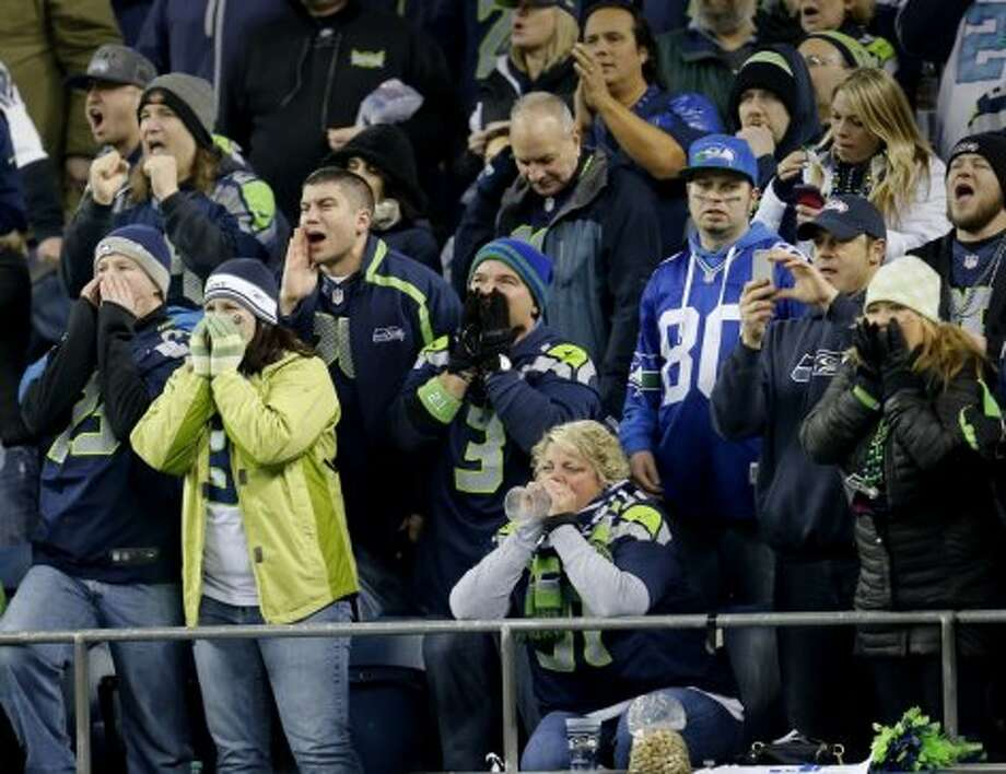Seattle fans yell and scream as their defense stops the 49ers in the second half Sunday January 19, 2014. The Seattle Seahawks defeated the San Francisco 49ers 23-17 to win the NFC championship and a trip to the Super Bowl at CenturyLink Field in Seattle, Washington. Photo: Brant Ward, The Chronicle