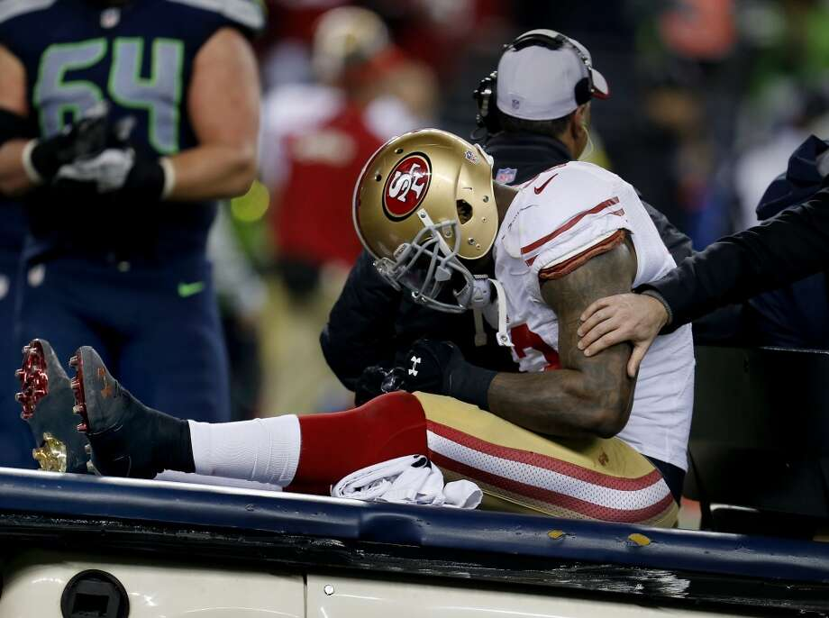 NaVorro Bowman is taken off the field after a second half injury Sunday January 19, 2014. The Seattle Seahawks defeated the San Francisco 49ers 23-17 to win the NFC championship and a trip to the Super Bowl at CenturyLink Field in Seattle, Washington. Photo: Brant Ward, The Chronicle