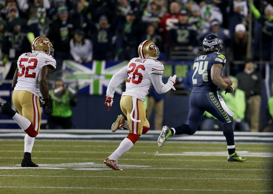 Mrshawn Lynch (24) heads downfield on a touchdown run in the second half Sunday January 19, 2014. The Seattle Seahawks defeated the San Francisco 49ers 23-17 to win the NFC championship and a trip to the Super Bowl at CenturyLink Field in Seattle, Washington. Photo: Brant Ward, The Chronicle