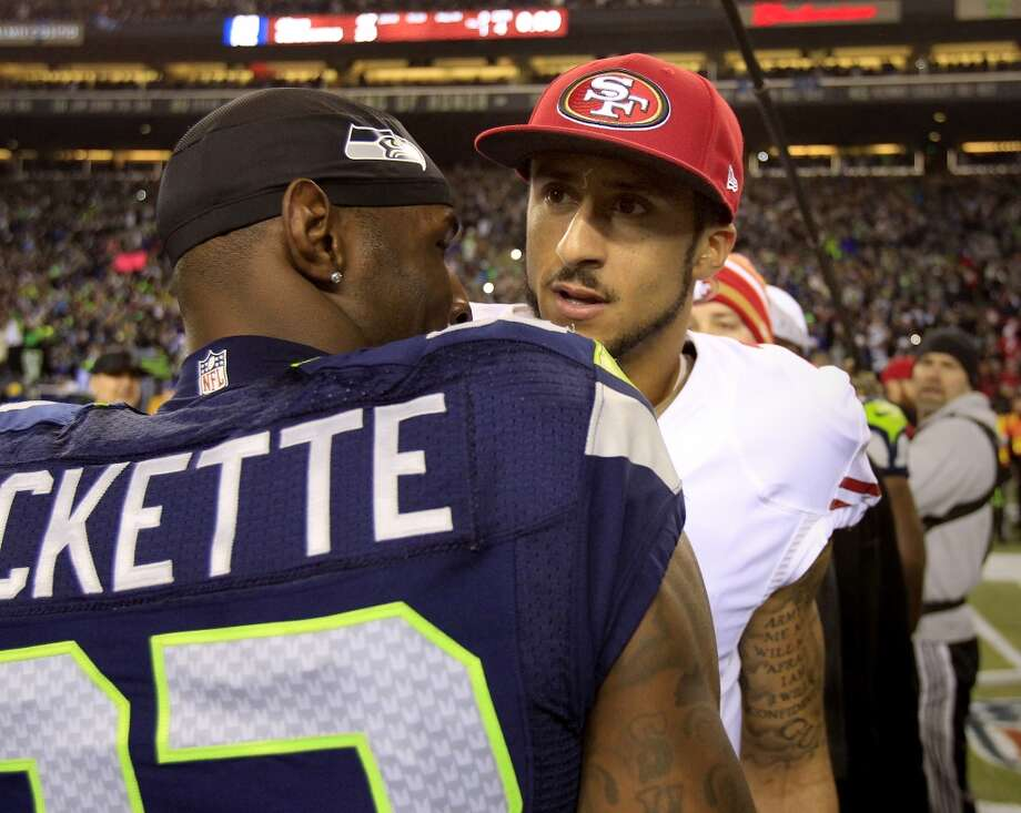 Colin Kaepernick and Ricardo Lockette met after the game Sunday January 19, 2014. The Seattle Seahawks defeated the San Francisco 49ers 23-17 to win the NFC championship and a trip to the Super Bowl at CenturyLink Field in Seattle, Washington. Photo: Brant Ward, The Chronicle