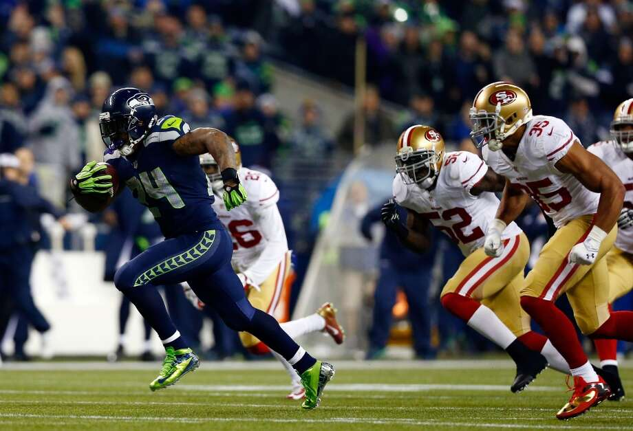 Running back Marshawn Lynch #24 of the Seattle Seahawks runs for a 40-yard touchdown in the third quarter against the San Francisco 49ers during the 2014 NFC Championship at CenturyLink Field on January 19, 2014 in Seattle, Washington. Photo: Tom Pennington, Getty Images
