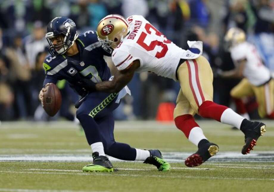49ers NaVorrow Bowman, (53) sacks Seattle quarterback Russell Wilson, (3) in the first quarter, as the San Francisco 49ers take on the Seattle Seahawks in the NFC Championship game at CenturyLink Field in Seattle, Washington on Sunday Jan. 19,  2014. Photo: Michael Macor, The Chronicle