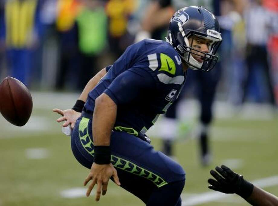 Russell Wilson (3) lost the ball on the first play of the game and fumbled. The San Francisco 49ers meet the Seattle Seahawks for the NFC title at CenturyLink field in Seattle, Washington Sunday January 19, 2014. Photo: Brant Ward, The Chronicle