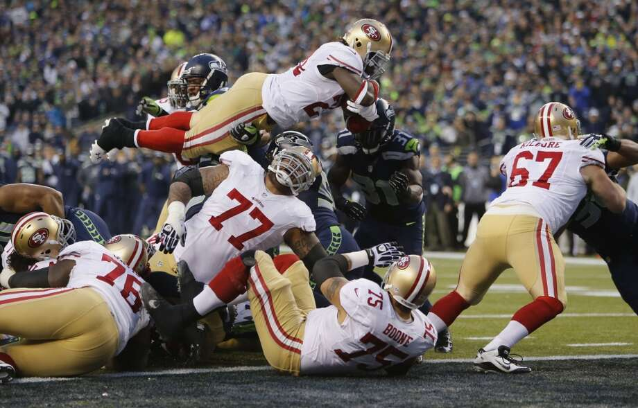 49ers' Anthony DIxon, (24) goes in from one yard out for a second quarter touchdown, as the San Francisco 49ers take on the Seattle Seahawks in the NFC Championship game at CenturyLink Field in Seattle, Washington on Sunday Jan. 19,  2014. Photo: Michael Macor, The Chronicle