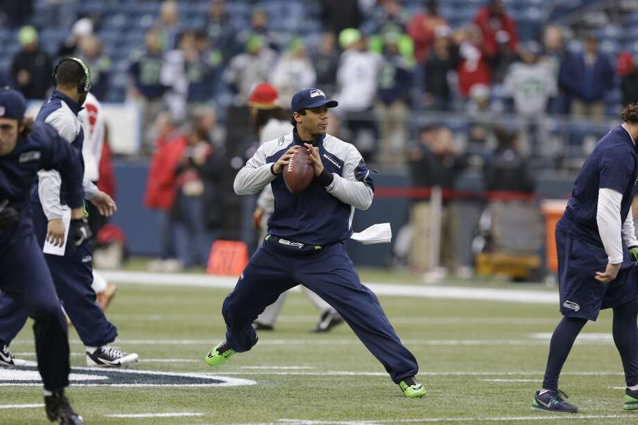 Seattle Seahawks' Russell Wilson works before the NFL football NFC Championship game against the San Francisco 49ers Sunday, Jan. 19, 2014, in Seattle. Photo: Elaine Thompson, Associated Press