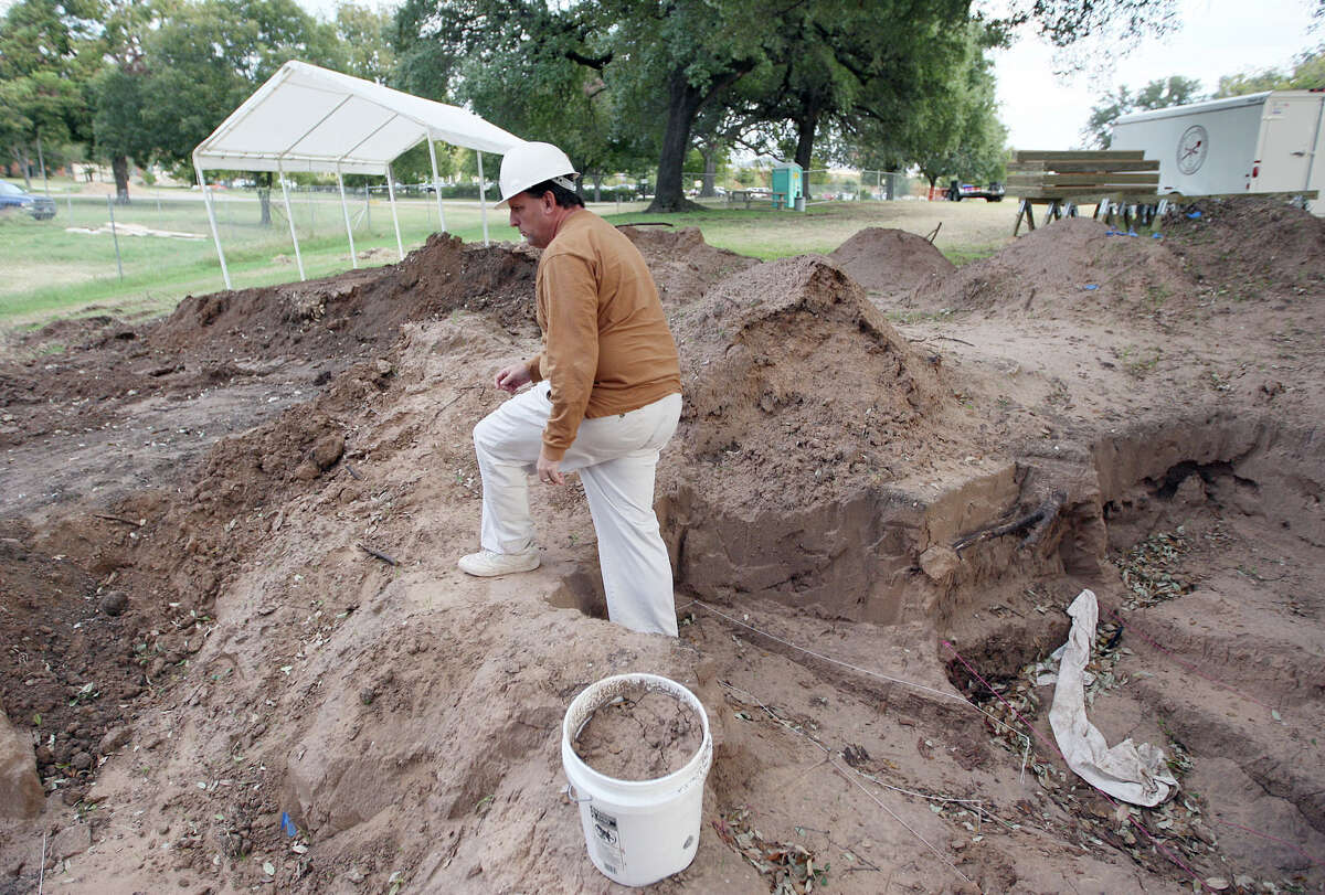 In this 2007 file photo, Michael Bradle walks out of the pit where they are digging to relocate the bones behind the Texas Ranger Hall of Fame. The new Texas Ranger Co. F building was built behind the Texas Ranger Museum near the Brazos River in Waco, Texas.