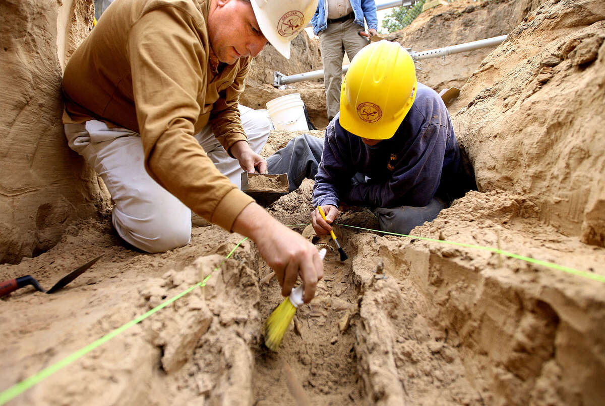 In this file photo, archaeologists work to unearth one graves sties located at the First Street Cemetery around 2008. The new Texas Ranger Co. F building is located behind the Texas Ranger Museum. More than 200 Waco residents remain in boxes at the Texas Ranger Museum after they were dug up nearly seven years ago to make way for the expansion. The graves were in a forgotten section of the historic cemetery after construction began.