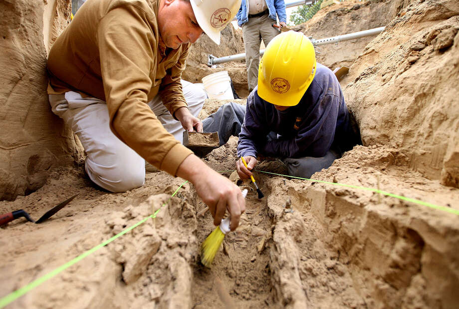 In this file photo, archaeologists work to unearth one graves sties located at the First Street Cemetery around 2008. The new Texas Ranger Co. F building is located behind the Texas Ranger Museum.  More than 200 Waco residents remain in boxes at the Texas Ranger Museum after they were dug up nearly seven years ago to make way for the expansion. The graves were in a forgotten section of the historic cemetery after construction began. Photo: Waco Tribune Harold