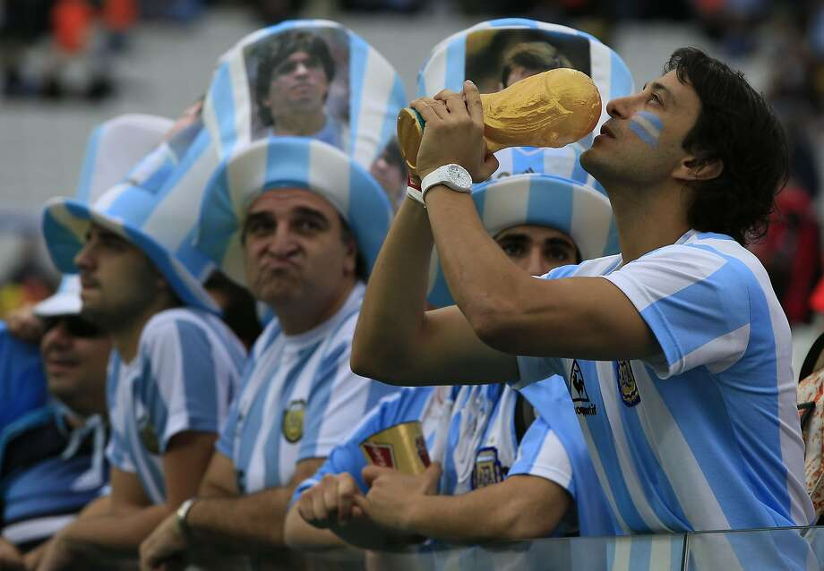 I swear upon the Holy Turkey Drumstick ... An Argentina fan appears to be praying for divine 