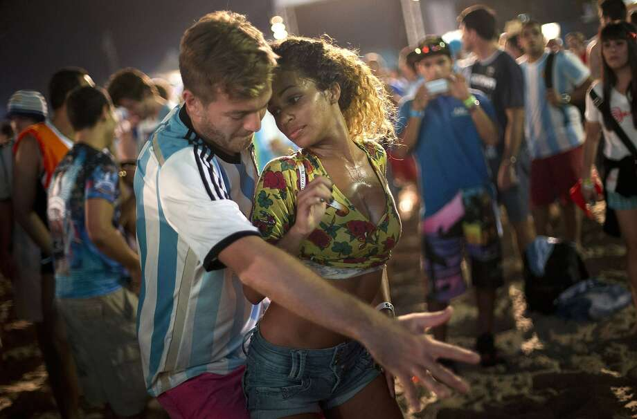 Fraternizing with the enemy?A Brazilian woman dances the samba with an Argentinian at the World Cup 