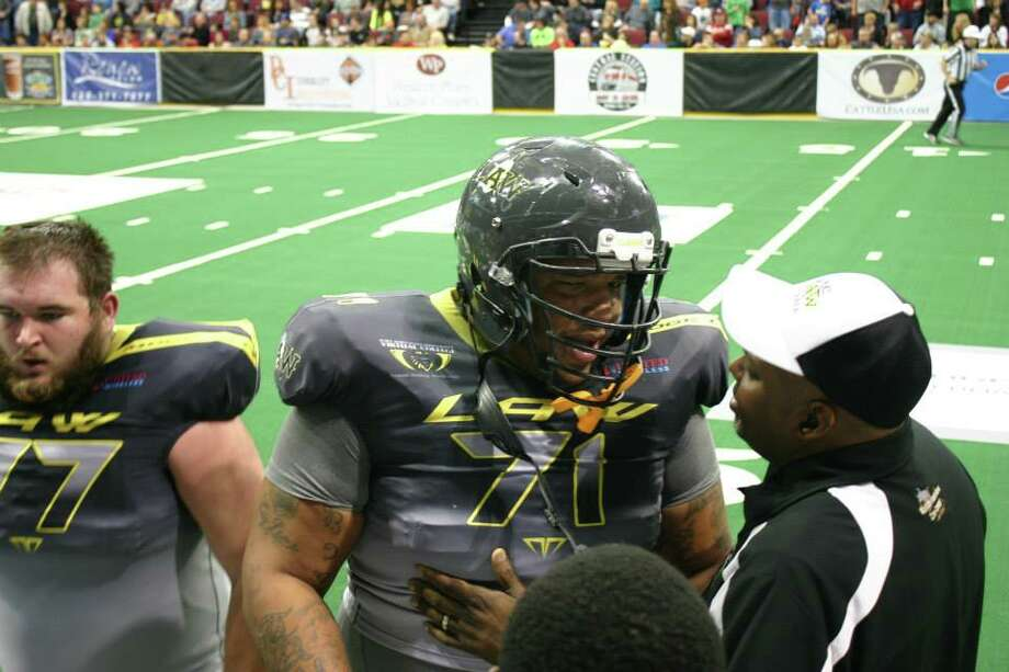 Dodge CIty Law lineman Mack Randall (No. 71) talks to an assistant coach during a Champions Indoor Football League game this past season. The 6-foot-8, 380-pound former Ozen star earned Second-Team All-CPIFL honors this season. Courtesy of Dodge City Law