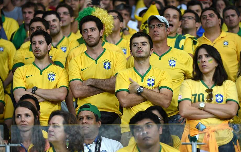 Brazil's fans react while watching a 7-1 loss to Germany, It was the Brazil national team's first loss on home soil since 1975. Photo: Li Ga, McClatchy-Tribune News Service
