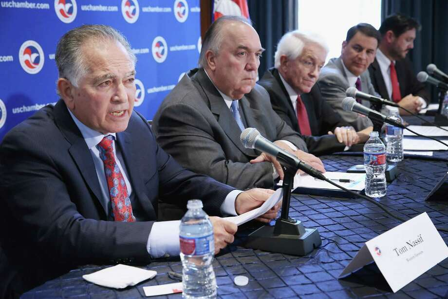 WASHINGTON, DC - JULY 09:  (L-R) Western Growers President and CEO Tom Nassif, Business Roundtable President and former Michigan Gov. John Engler, U.S. Chamber of Commerce President and CEO Thomas Donohue, National Association of Manufactureres President and CEO Jay Timmons and John Stineman from the Partnership for a New American Economy participate in a news conference as part of a 'Day of Action for Immigration Reform' at the U.S. Chamber of Commerce July 9, 2014 in Washington, DC. According to a Partnership for a New American Economy survey supported by the business leaders, 86-percent of those polled want Congress to undertake immigration reform and 70-percent said they would vote for a presidential candidate from a party that is viewed as supporting immigration reform.  (Photo by Chip Somodevilla/Getty Images) Photo: Chip Somodevilla, Staff / 2014 Getty Images